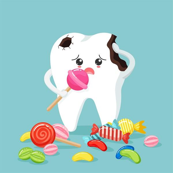 Entenda como prevenir cáries sem parar de comer doces